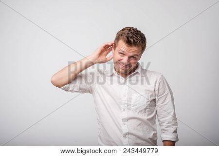 Caucasian Man Having Doubts. Concept Og Unsure Emotions Inside.