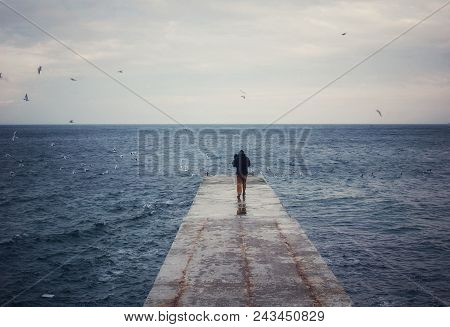 Winter Sea And Pier, The Man Goes Into The Distance. Blue Cold Colors, Loneliness, Silence, Riot