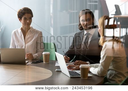 Business Partners Negotiating In Meeting Room, Having Conversation About Company Corporate Strategy,