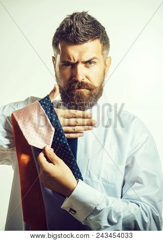 Bearded Man With Fashionable Hair Chooses Tie. Fashion, Style, Lifestyle, Business, People Concept -