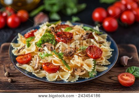 Italian Pasta With Sauce, Cherry Tomatoes, Basil And Parmesan Cheese. Delicious Pasta Plate. Vegan P