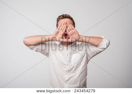 Attractive Young Caucasian Man Shouting. Concept Of Making An Important Announcement