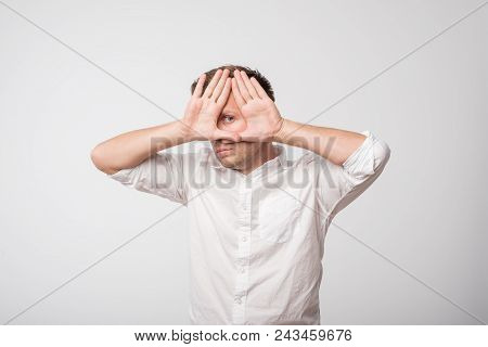 Young Caucasian Man Hiding His Face With Hand. Concept Of Being Shy And Having Problem