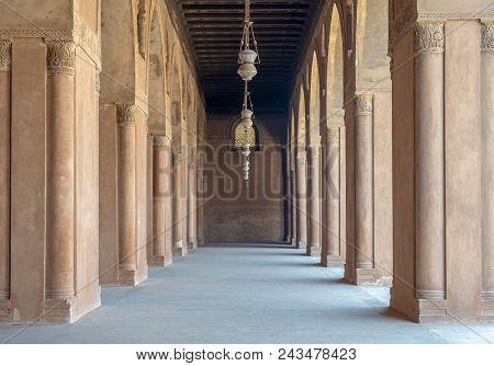 Corridor Surrounding The Courtyard Of The Mosque Of Ahmad Ibn Tulun Framed By Huge Decorated Arches,