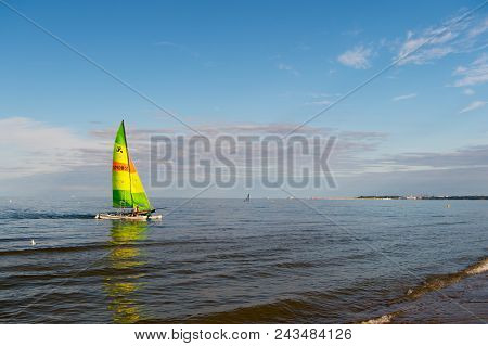 Gdansk, Poland-september 19, 2016 : Boat With Bright Sail Sailing In Sea Of Gdansk, Poland. Sailboat