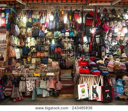 SEOUL-SOUTH KOREA, MAY 17, 2018:  Stand with bags, purses and hats for sale into a Namdaemun traditional Market in South Korea.  It is the oldest and largest market in Korea.  Contents