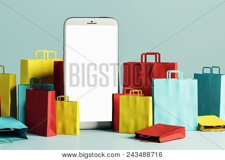 Empty Smartphone With Shopping Bags On Light Background. Online Shopping And Mobile Concept. Mock Up