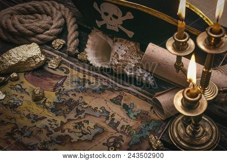 Pirate Treasure Map, Gold Nuggets And Pirate Hat On Aged Wooden Table Background. Sea Travel.