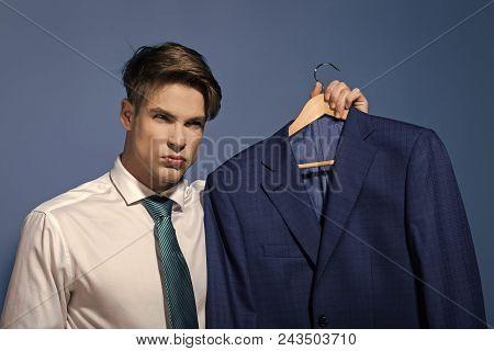 Serious Man. Businessman In White Shirt, Necktie Hold Jacket On Hanger On Blue Background. Business