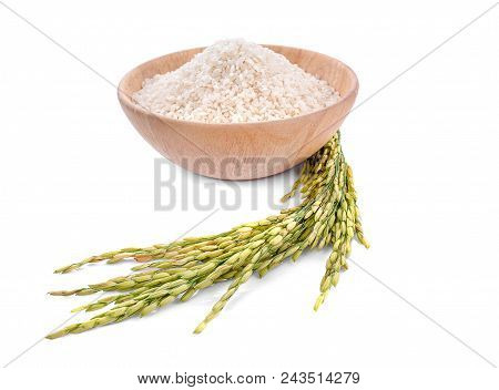 White Rice (thai Jasmine Rice) In Wooden Bowl And Unmilled Rice Isolated On White Background