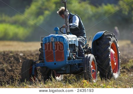 Old Tractor Ploughing Field