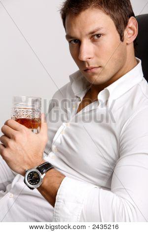 Businessman Holding Glass