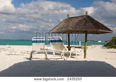 Sunbeds On Beach