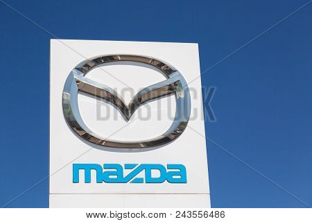 Moscow, Russia - May, 2018: Mazda Automobile Dealership Sign Against Blue Sky. Mazda Is A Japanese M