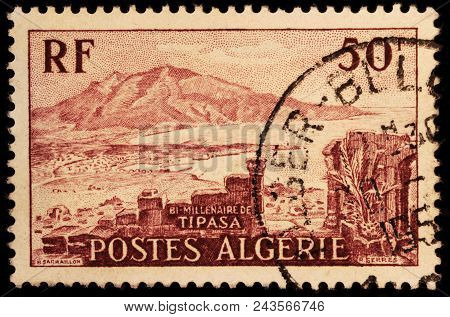 Luga, Russia - January 23, 2018: A Stamp Printed By Algeria Shows View Of Chenoua Mountain And Tipaz