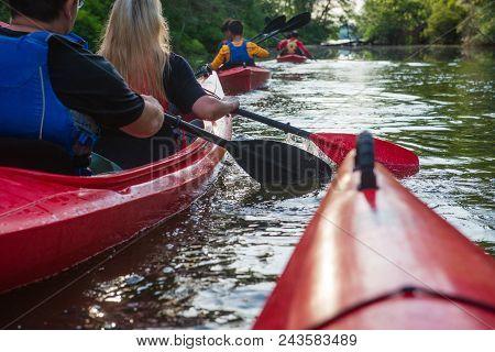 People In Kayaks On The River. Kayaking