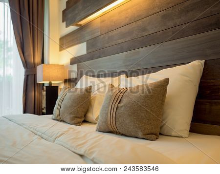 Empty Double Bed And Lamp On Side Of Bed In Luxury And Natural Style Bedroom Is Decorated With Woode