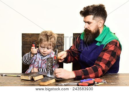 Concept Of Repair&assistance - Concentrated Cute Little Boy Learning To Use Tools With Dad. Father&s