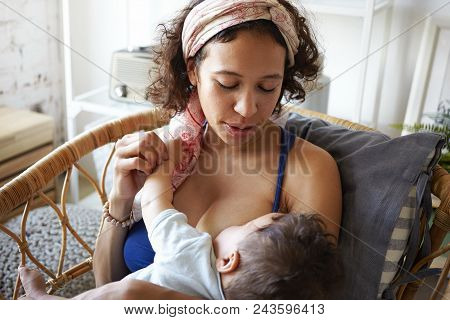 Infancy, Motherhood, Nutrition, Lactation And Breastfeeding Concept. Indoor Portrait Of Tender Attra