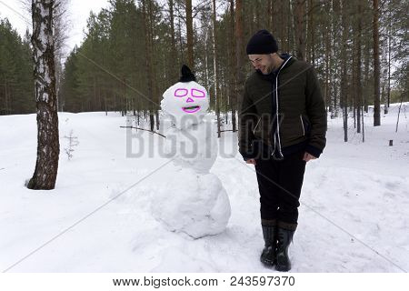 Snowman Family Made Of White Snow Christmas Man With Long Beard. New Year Guy On Blue Sky With Snow