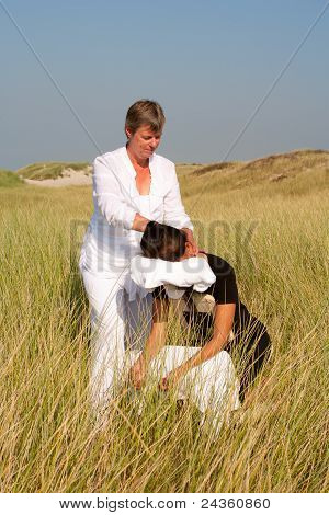 Chair massage in the dunes on the island Ameland, the Netherlands poster