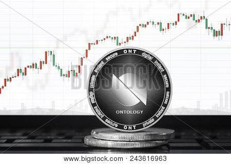 Ontology (ont) Cryptocurrency; Ontology Coin On The Background Of The Chart