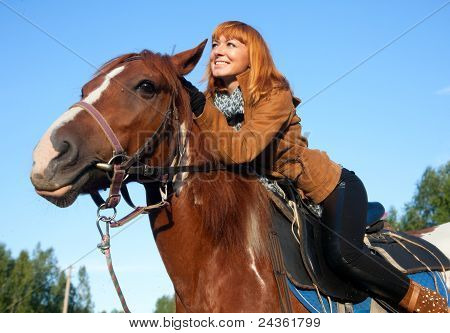 Young woman on a red horse mare equestrian poster
