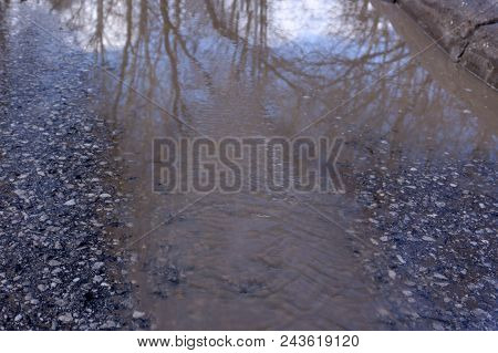 Spring Has Come, Snow Is Melting And A Huge Puddle Has Formed On The Road. Snow Puddle, Spring Tide,