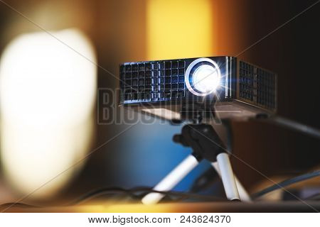 Real Projector At Business Conference Or Presentation In The Office Room. Close Up Of Projector For