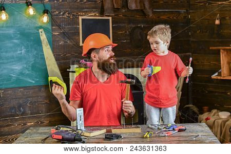 Father, Parent With Beard In Protective Helmet Teaching Little Son To Use Different Tools In School