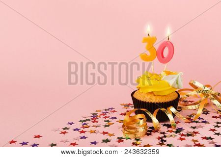 Thirty Birthday Cupcake With Candle And Sprinkles On Pink Background. Card Mockup, Copy Space. Birth
