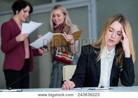 office rush and buzz. woman with a headache in busy and noisy workspace can't concentrate on work poster