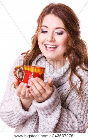 Woman Wearing Warm Clothing Grey Sweater Holding Nice Red Mug Of Warm Beverage Tea Or Coffee, Isolat