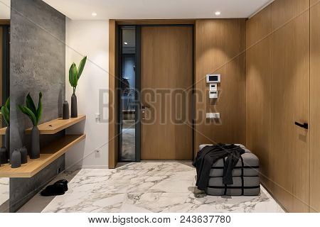 Luminous Corridor With An Entrance Door In A Modern Interior With Different Walls And Tiled Floor. T
