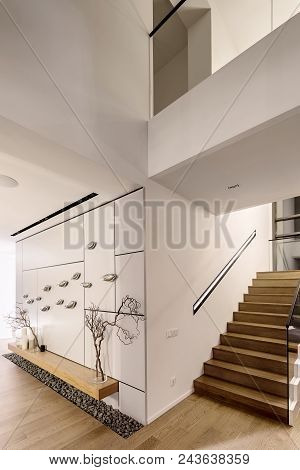Luminous Modern Interior With White Walls And A Stair With Wooden Rungs And A Glass Railing. There I