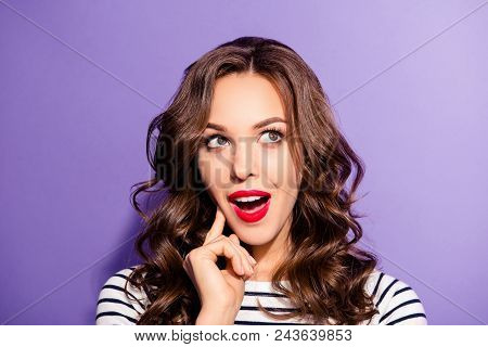 Portrait of funny dreamy girl with vivid bright pomade find idea solution decision  looking up with open mouth guessing answer isolated on violet background poster