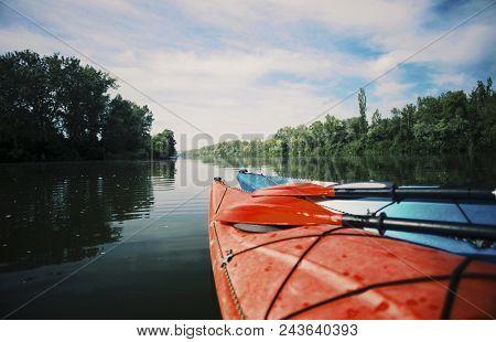 Kayaking On The Lake Concept Photo. Sport Kayak On The Rocky Lake Shore. Close Up Photo.