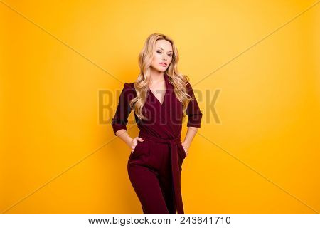 Portrait Of Stylish Stunning Lady,  Haughty Seductive Woman Holding Two Hands In Pockets Looking At