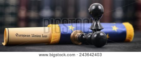 European Union Law Wrapped In A European Union Flag ,  Notary Seals On The Wooden Background.