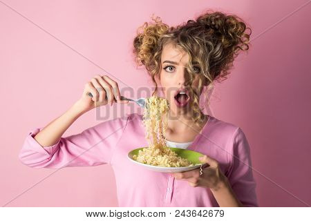 Fashion Girl Eating Noodles. Female Hold Plate Of Spaghetti. Morning Breakfast - Attractive Woman Ea