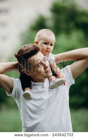 Young Father Piggyback Adorable Little Daughter. Daddy And Child