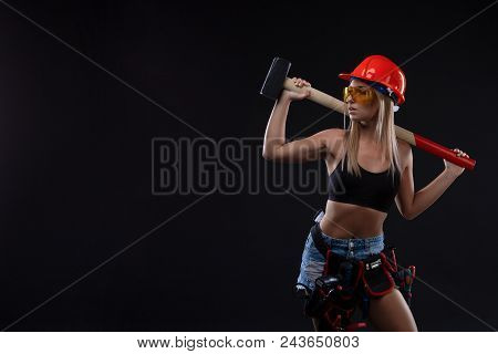 Sex Equality And Feminism. Sexy Girl In Safety Helmet Holding Hammer Tool. Attractive Woman Working