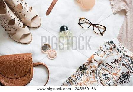 Feminine Flat Lay, Fashion Bloggers Beauty Objects, Clothing, Perfumes And Accessories On White Back