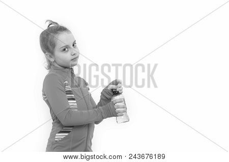 Child feel thirsty in pink suit isolated on white. Girl with bottle of drinking water. Health and healthy drink. Dehydration thirst concept. Fluid balance, hydration copy space poster