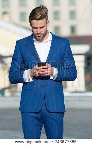 Message Concept. Man In Suit Businessman Takes Advantages Of Modern Mobile Technologies. Man Reads M