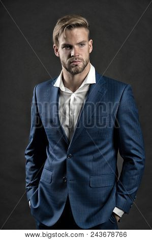 Businessman Attractive Cares About Appearance. Man Bearded Strict Face With Hairstyle, Dark Backgrou
