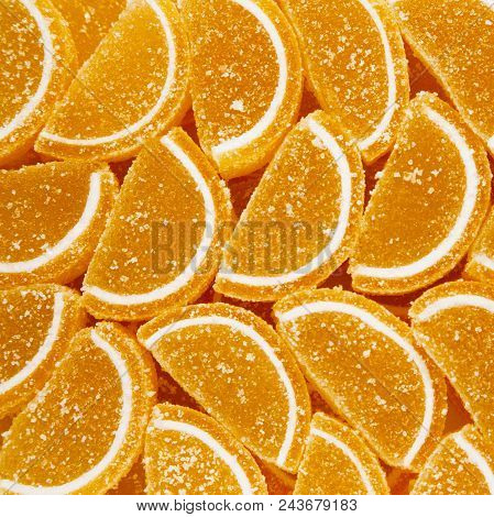 Decorative Background of marmalade candy in shape of citrus fruits wedges. Jelly sweet candies. Food Texture. Beautiful square Wallpaper or Web banner. Top view. Flat lay poster