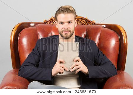 Businessman Formal Suit Sit On Leather Chair, Grey Background. Man Calm Face Reading Book Studying,