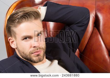 Businessman Bearded Confident Face, Leather Chair Background. Metrosexual Concept. Man Bearded Unsha