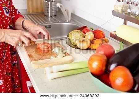 Senior Woman's Hands Cutting Vegetables
